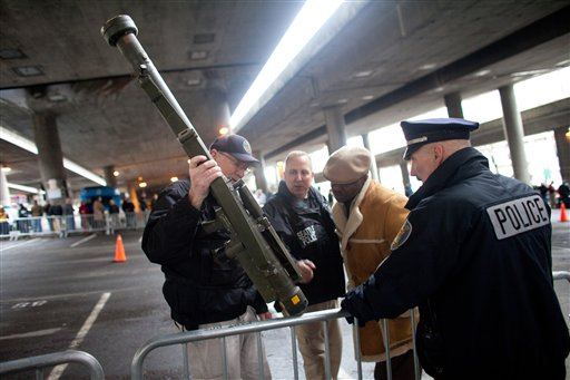 Seattle police officers examine a surface-to-air missile launcher brought to the gun buyback program.