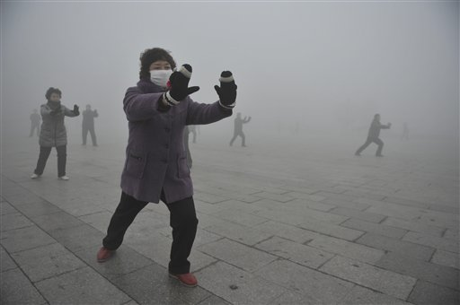 Retirees do Taichi during their morning exercise on a hazy day in Fuyang city, in central China's Anhui Province in this May 2014 photo. The Associated Press