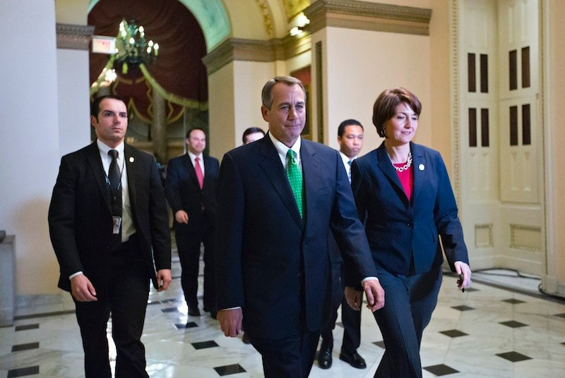 Speaker of the House John Boehner, R-Ohio, and Rep. Cathy McMorris Rodgers, R-Wash., right, the Republican Conference Chair, arrive at the House of Representatives for the final vote on emergency legislation to avoid a national