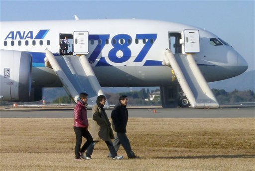 Passengers leave an All Nippon Airways Boeing 787 after it made an emergency landing at Takamatsu airport in Takamatsu, Japan, on Wednesday.