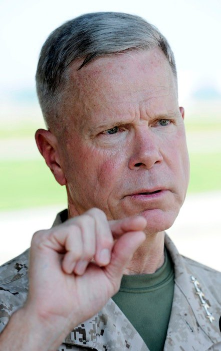 In this July 29, 2011 file photo, Marine Corps Commandant Gen. James Amos speaks with reporters at Patuxent River Naval Air Station, Md. The Marine Corps commandant said Thursday Jan. 31, 2013, the infantry side is skeptical about how women will perform in those units and some positions may end up being closed if not enough females fail to meet the rigorous standards. (AP Photo/Cliff Owen, File)
