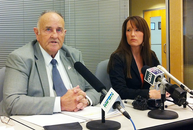 Sawin Millett Jr., the commissioner of the Maine Department of Administrative and Financial Services, and Adrienne Bennett, Paul LePage's spokeswoman, at a press conference Monday, Dec. 3, 2012. Last year, Millett earned a $101,215 salary as part of the LePage administration while also collecting $24,951 in pension benefits, according to Public Employee Retirement System data.