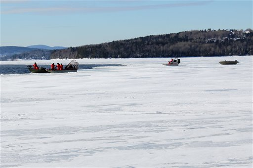 In this photo provided by the Maine Warden Service, wardens conduct search operations on Thursday for the three missing snowmobilers presumed to be in Rangeley Lake. Wardens used sonar to scan the lake bottom for approximately two hours before equipment became inoperable due to weather.