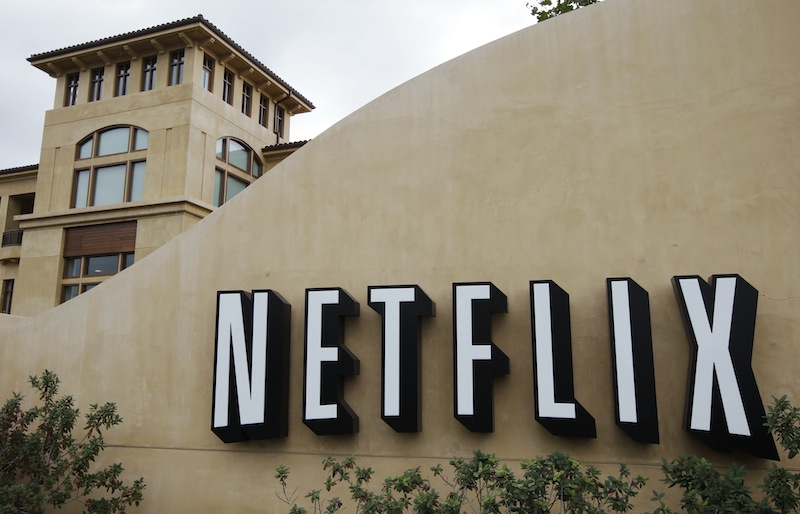 In this Oct. 10, 2011, file photo, the exterior of Netflix headquarters is seen in Los Gatos, Calif. Netflix stock, on Thursday, Jan. 24, 2013, is on its way to its biggest one-day gain since the video subscription service went public more than a decade ago. (AP Photo/Paul Sakuma)