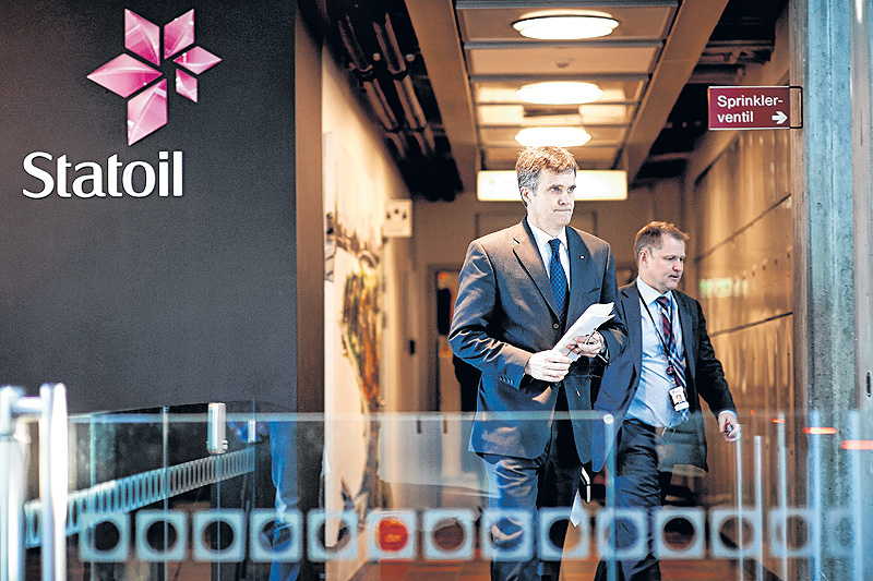 Statoil CEO Helge Lund, left, and director of foreign operations Lars Christian Bacher leave a meeting at the Statoil headquarters building in Stavanger, Norway, during Thursday's hostage crisis.