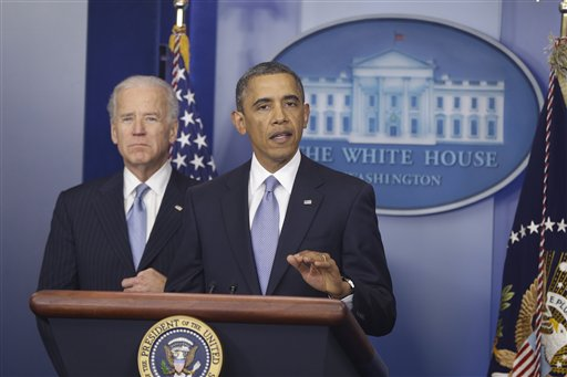 President Barack Obama and Vice President Joe Biden make a statement regarding the passage of the fiscal cliff bill in the Brady Press Briefing Room at the White House Tuesday.