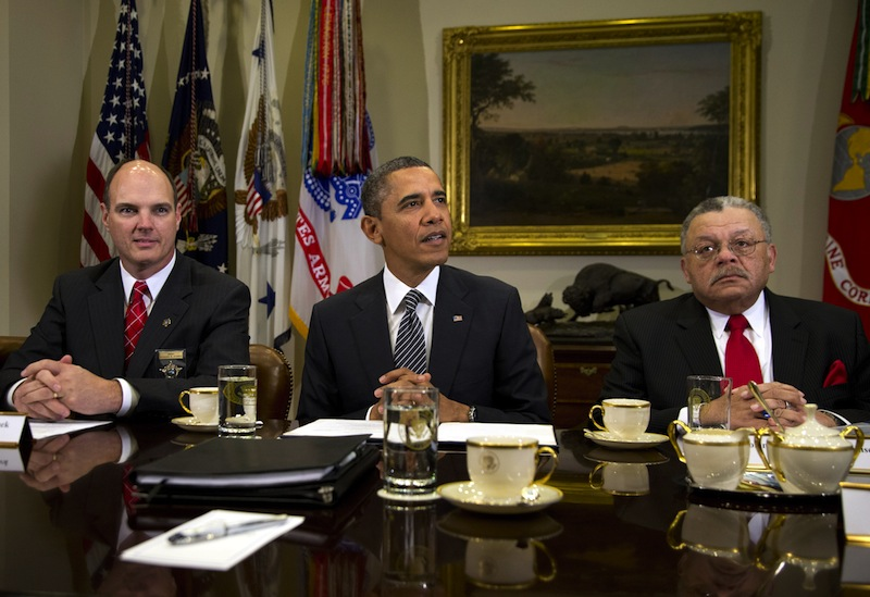 President Barack Obama meets with representatives from Major Cities Chiefs Association and Major County Sheriffs Association in the Roosevelt Room of the White House, Monday, Jan. 28, 2013, in Washington, to discuss policies put forward by President Obama to reduce gun violence. Hennepin County Minnesota Sheriff Richard W. Stanek, President Obama, is left, and Charles H. Ramsey Police Commissioner of the Philadelphia Police Department is right. (AP Photo/Carolyn Kaster)