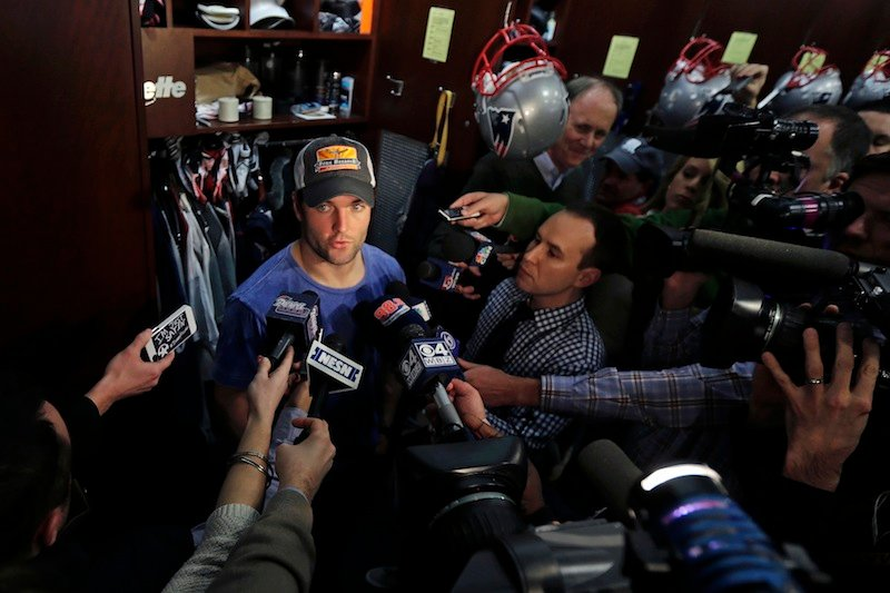 New England Patriots wide receiver Wes Welker is surrounded by members of the media in the locker room after an NFL football practice in Foxborough, Mass., Wednesday, Jan. 2, 2013. (AP Photo/Charles Krupa)