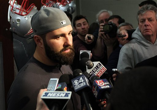 New England Patriots defensive end Rob Ninkovich talks with the media in the locker room at Gillette Stadium on Monday.