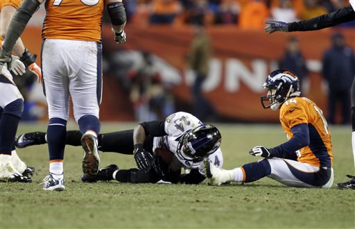 Baltimore Ravens cornerback Corey Graham comes up with an interception of a pass intended for Denver Broncos wide receiver Brandon Stokley in overtime Saturday. The Ravens won 38-35. Sports Authority Field at Mile High Stadium