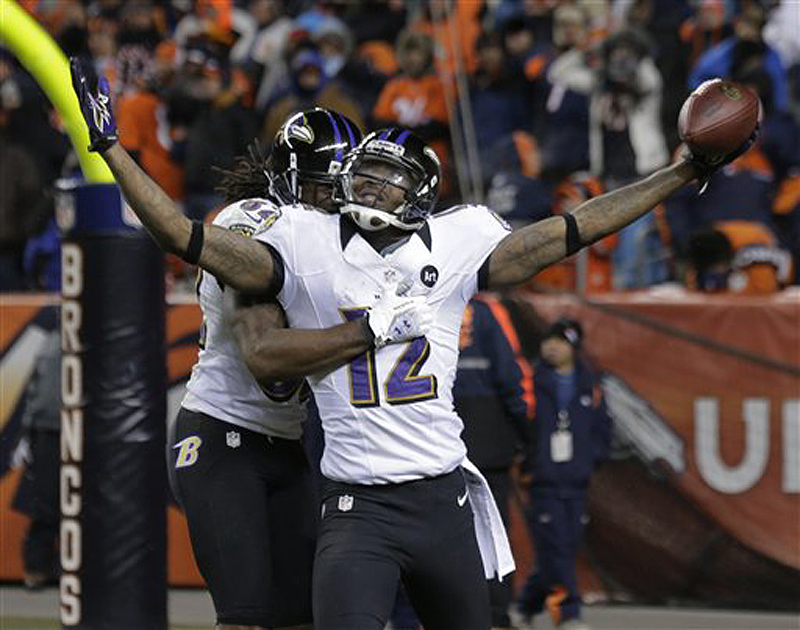 Baltimore Ravens wide receiver Jacoby Jones (12) celebrates with Ravens wide receiver Torrey Smith (82) after scoring a touchdown against the Denver Broncos to tie the score late in the fourth quarter of their AFC divisional playoff game Saturday in Denver. The Ravens won 38-35 in double overtime.