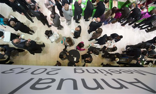 Participants throng the Congress Center during the 43rd annual meeting of the World Economic Forum in Davos, Switzerland, on Saturday. Those at the annual gathering of the world's elite don't shy away from making predictions, even if they missed foreseeing germinal events like the Great Recession or the Arab Spring revolts.