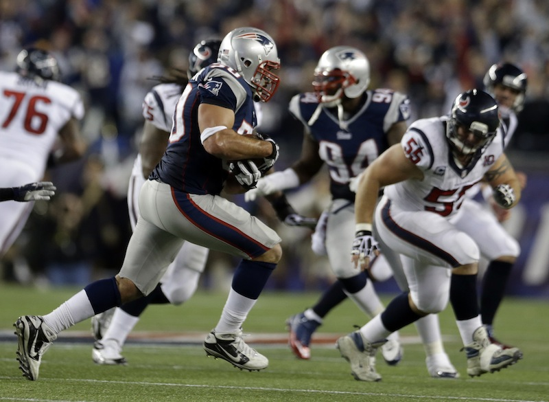 New England Patriots defensive end Rob Ninkovich (50) runs with the ball after intercepting a pass intended for Houston Texans fullback James Casey during the second half of an AFC divisional playoff NFL football game in Foxborough, Mass., Sunday, Jan. 13, 2013. (AP Photo/Elise Amendola)