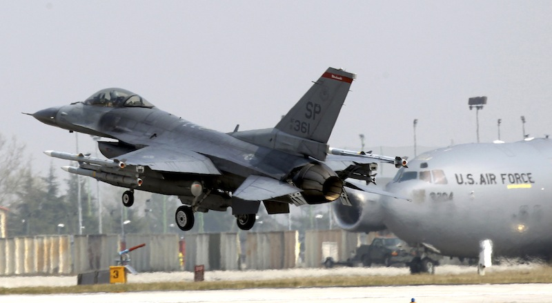 In this file photo a 31st Fighter Wing United State Air Force F-16 jet fighter lands at the Aviano NATO airbase, in Aviano, Italy, Friday, March 25, 2011. The headquarters of the 31st Fighter Wing issued a brief statement saying they lost contact with a F-16 fighter with one pilot aboard Monday, Jan. 28, 2013, during a training mission off the coast of Italy. Initial word was that the F-16 was not carrying weapons. There was no immediate word on the fate of the plane or the pilot. In background a C-17 plane is seen. (AP Photo/Luca Bruno)