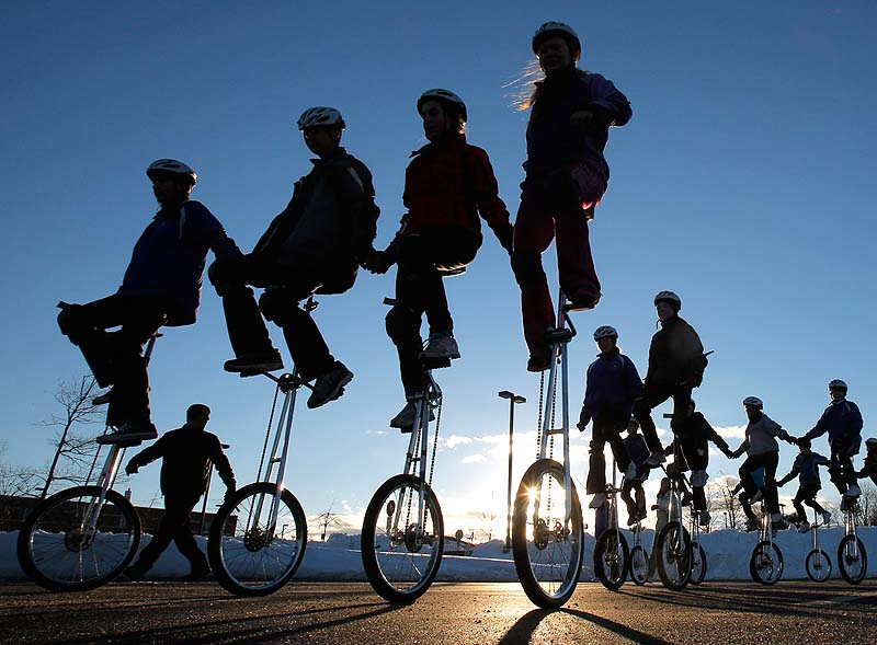 Members of the Gym Dandies Children's Circus practice riding unicycles in formation at Scarborough High School on Saturday in preparation for the Presidential Inaugural Parade.