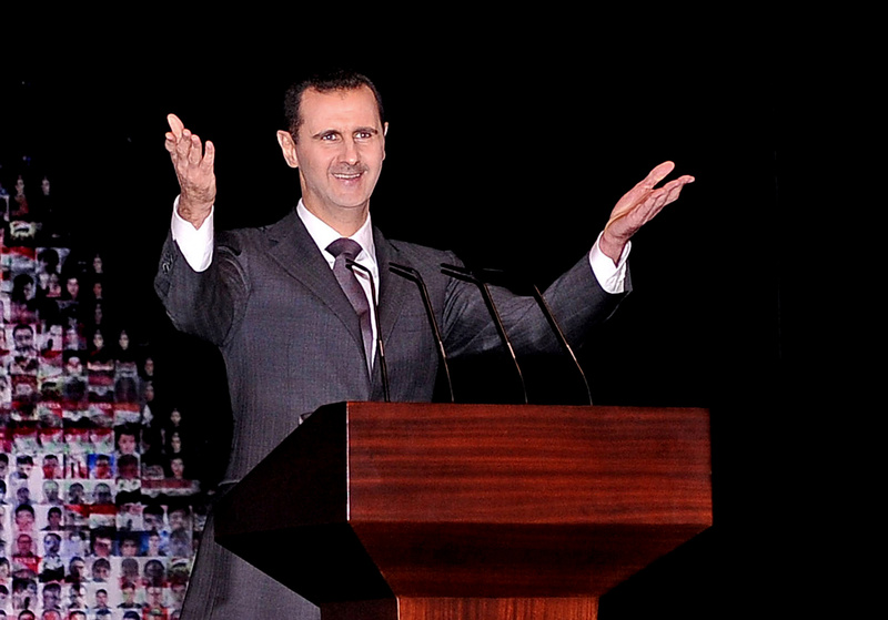 Syrian President Bashar Assad speaks at the Opera House in Damascus on Sunday.