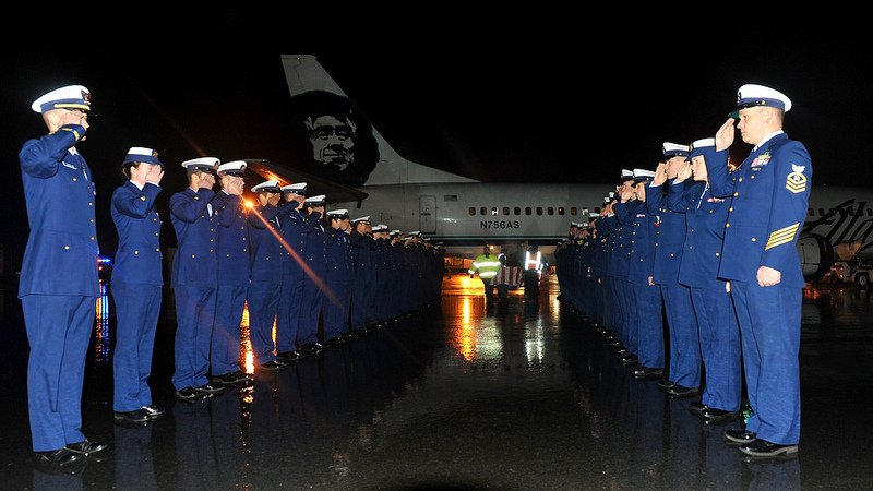 The crew of the Coast Guard Cutter Munro renders honors to their fallen shipmate Fireman Derek Russell at the Kodiak State Airport in Kodiak, Alaska, Thursday, Dec. 27, 2012. Russell, who suffered a fatal fall while hiking on Barometer Mountain Sunday, was recovered by Alaska State Troopers, Kodiak Island Search and Rescue and the Coast Guard Tuesday following several searches for him. U.S. Coast Guard photo by Petty Officer 1st Class Sara Francis.