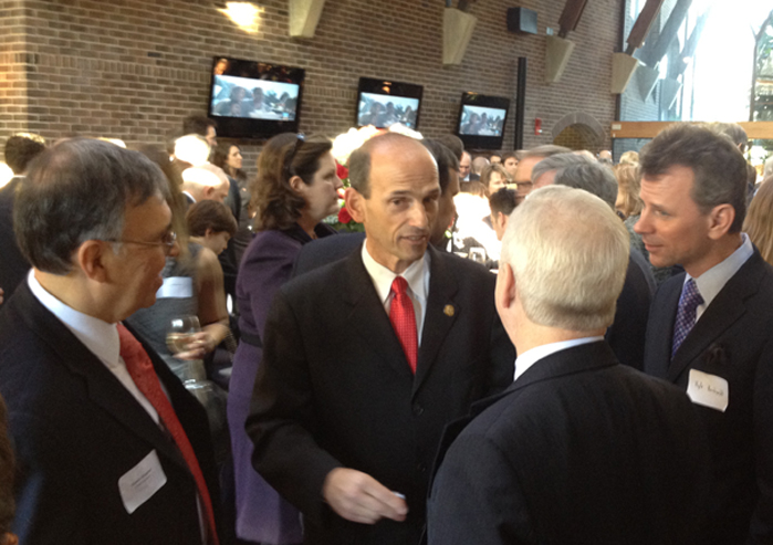 Former Maine Gov. John Baldacci, a Democrat, speaks with a group at a Maine-centered inaugural party in Washington, D.C.,Sunday. The party was co-hosted by the Maine law firm Preti Flaherty Beliveau & Pachios and the New Zealand Embassy.