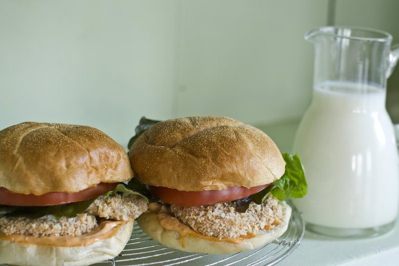 Buttermilk-soaked pork tenderloin cutlet sandwiches. The acid in the buttermilk also helps to tenderize the meat
