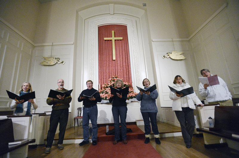 Members of the Choral Art Camerata rehearse at Woodfords Congregational Church last Sunday.