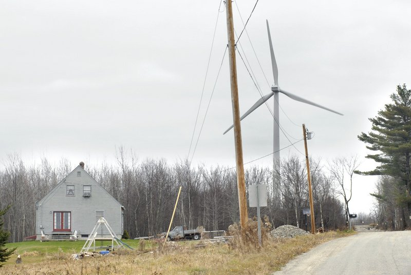 "Wind turbines like this one in Freedom help in ""preserving Maine's beauty while filling its energy needs,"" a reader says."