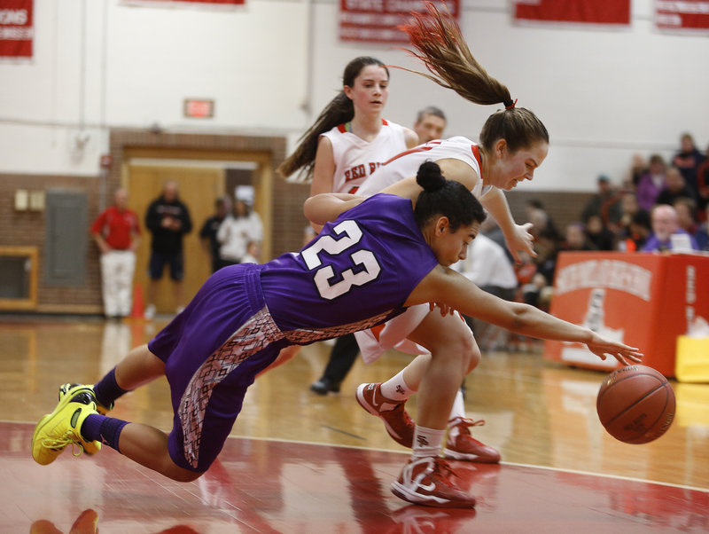 Keneisha DiRamio of Deering dives in an attempt to reach a loose ball ahead of Danica Gleason of South Portland during their games between undefeated SMAA teams Monday. Deering came away with a 45-37 victory on the road.