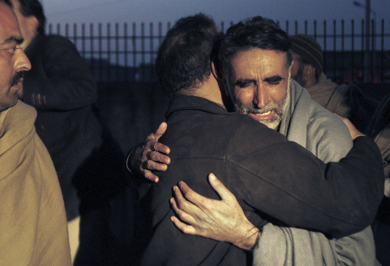A father of an aid worker who was killed by gunmen mourns the death of his daughter at a hospital in Swabi, Pakistan, Tuesday. Gunmen in northwest Pakistan killed at least five female teachers and two aid workers in an ambush on a van carrying workers home from their jobs at a community center, officials said.