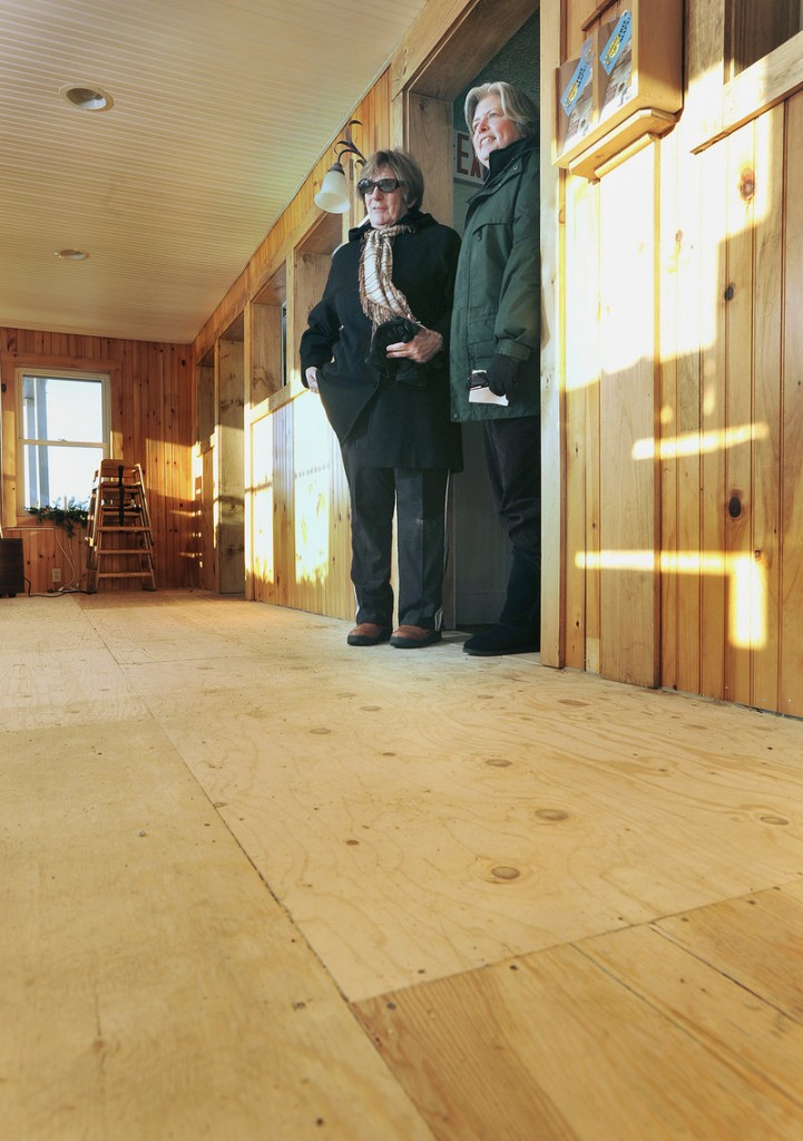 Joan Mercier, owner of the Freeport Cafe, is one of numerous customers jilted by a flooring store that went out of business. Mercier, left, and her assistant manager, Pam Bird, stand in the doorway of a recently built addition to the restaurant, which is currently without carpet.