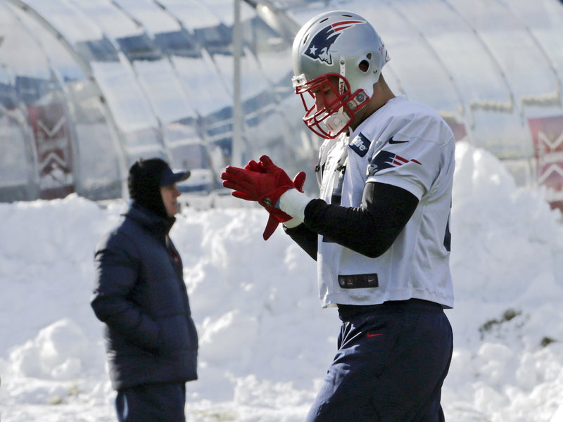 Tight end Aaron Hernandez gets ready to run a drill during a chilly New England Patriots practice session Wednesday in Foxborough, Mass.