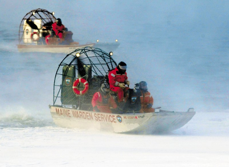 A warden service airboat, in front, slides back onto ice as a second boat motors in open water on Rangeley Lake on Thursday.