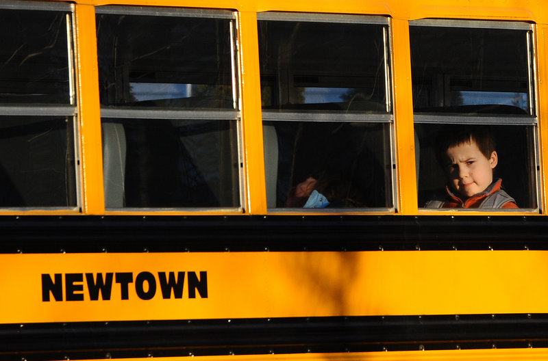 A Newtown bus leaves school Thursday in Monroe, Conn., after the first day of classes since the Dec. 14 massacre at Sandy Hook Elementary in Newtown. The vacant Chalk Hill School in Monroe was renamed Sandy Hook Elementary and overhauled to house the students.