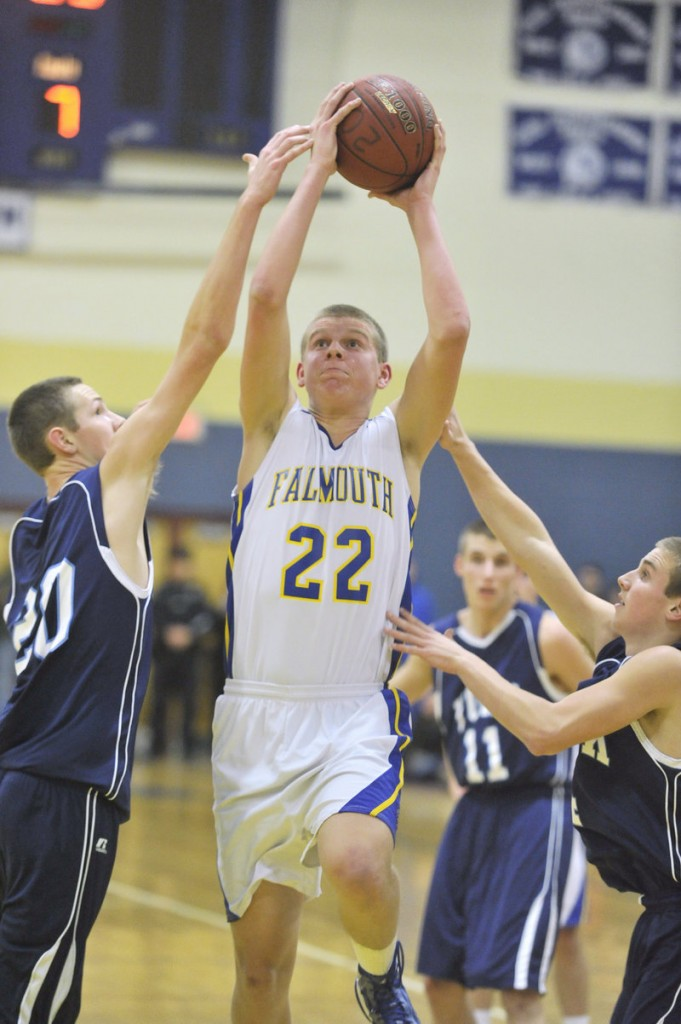 Jack Simonds of Falmouth goes up for a shot against York's Adam Bailey in Thursday night's game. Simonds had 10 of his 16 points in the first quarter.