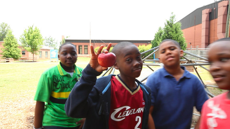 Hutchinson Elementary fifth-graders Marshall Jackson, Jayquan Jones, Robert Couch and Carmani Brown, calling themselves The ShortyZ, won the Dunk the Junk rap contest.