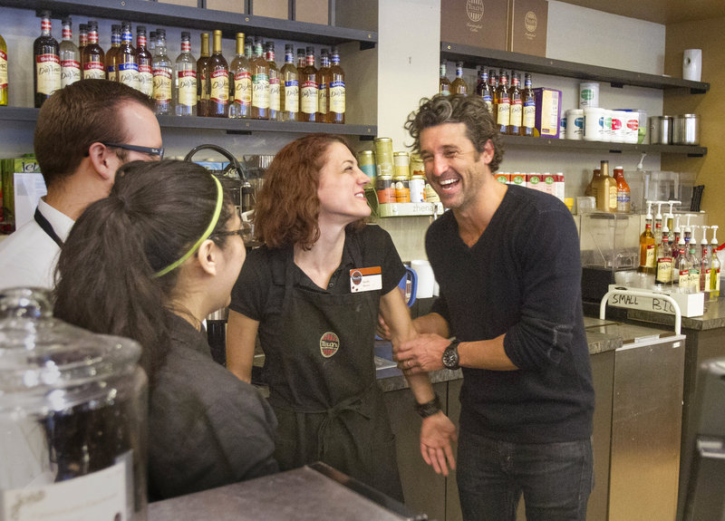 "Maine native and ""Grey's Anatomy"" star Patrick Dempsey, right, meets the staff at the Tully's Coffee near the Pike Place Market in Seattle on Friday. His Global Baristas company won a bankruptcy auction to purchase the chain."