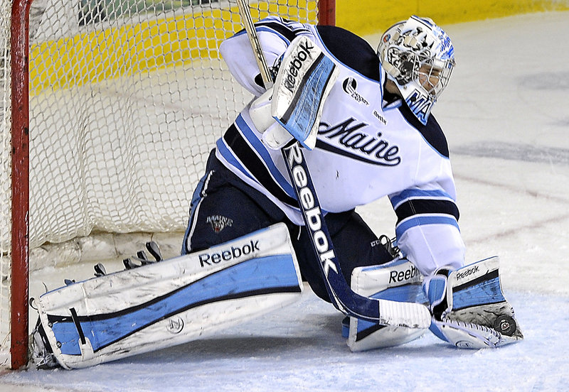 "Maine's Martin Ouellette had an outstanding night in the nets, as he finished with 25 saves, including some ""absolute game-savers."""
