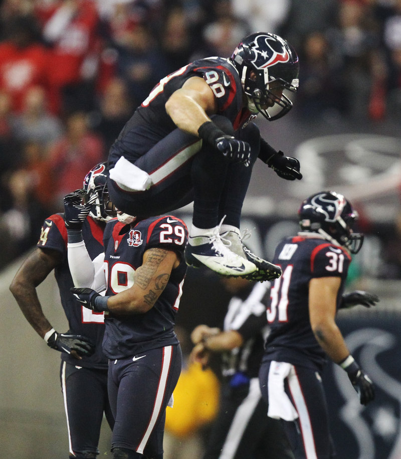 Houston linebacker Connor Barwin jumps for joy after stopping a Cincinnati drive during the fourth quarter of Saturday's game, won by the Texans.