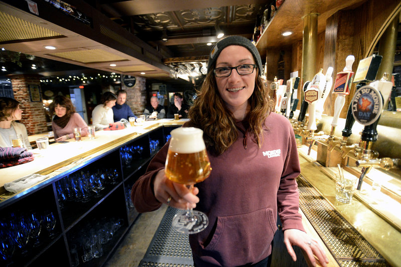 Erika Colby, a bartender at Novare Res Bier Cafe, shows off a Bavik Petrus Aged Pale Ale.