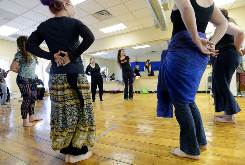 Joie Grandbois, center, demonstrates theatrical belly dancing at Bright Star World Dance in Portland.