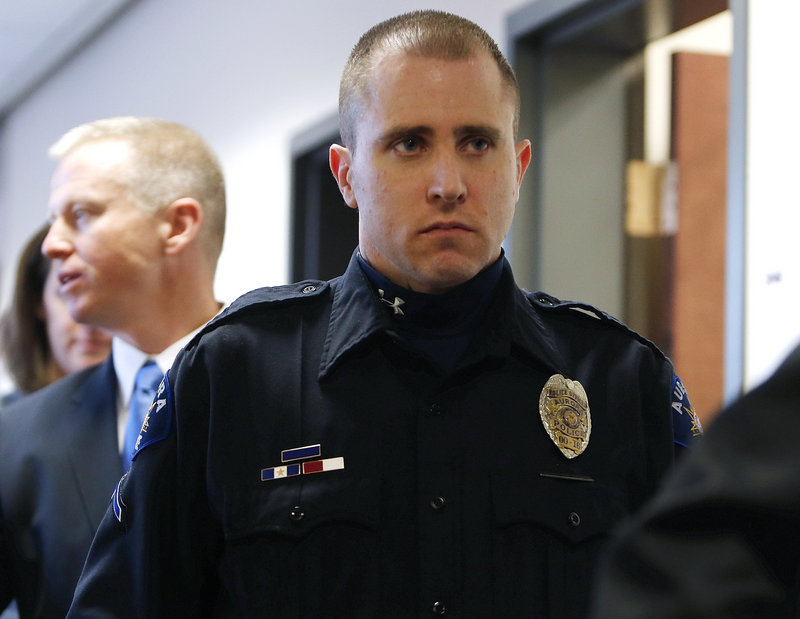 Aurora Police Officer Justin Grizzle leaves court after testifying at a preliminary hearing for James Holmes at the courthouse in Centennial, Colo., on Monday.
