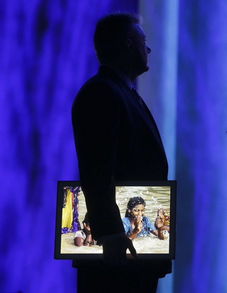 Panasonic's CEO North America Joe Taylor holds a 20-inch 4K tablet during a keynote address at the Consumer Electronics Show Tuesday.