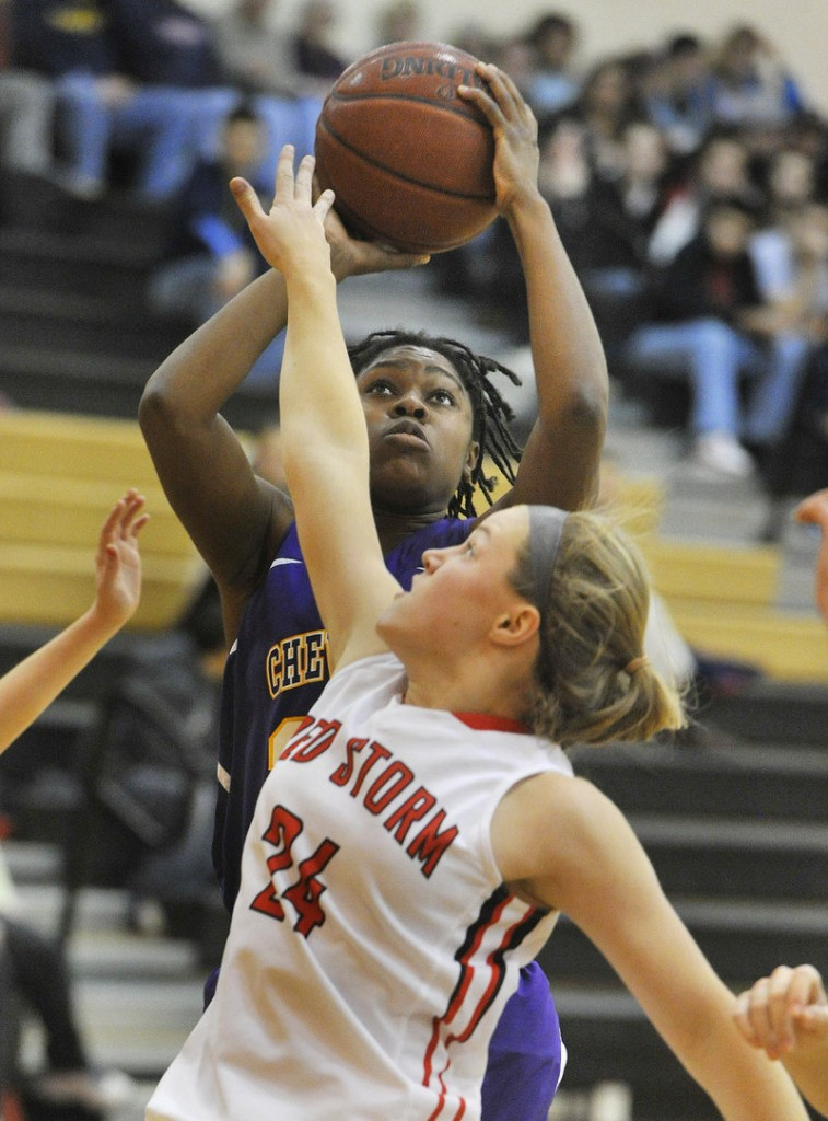 Sadie Lyons of Cheverus gets off a shot over Sam Sparda of Scarborough during Cheverus' 58-57 victory in triple-overtime Tuesday night.