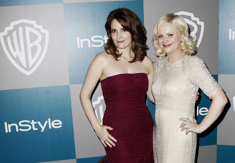 Tina Fey, left, and Amy Poehler co-host Sunday's Golden Globes ceremony.