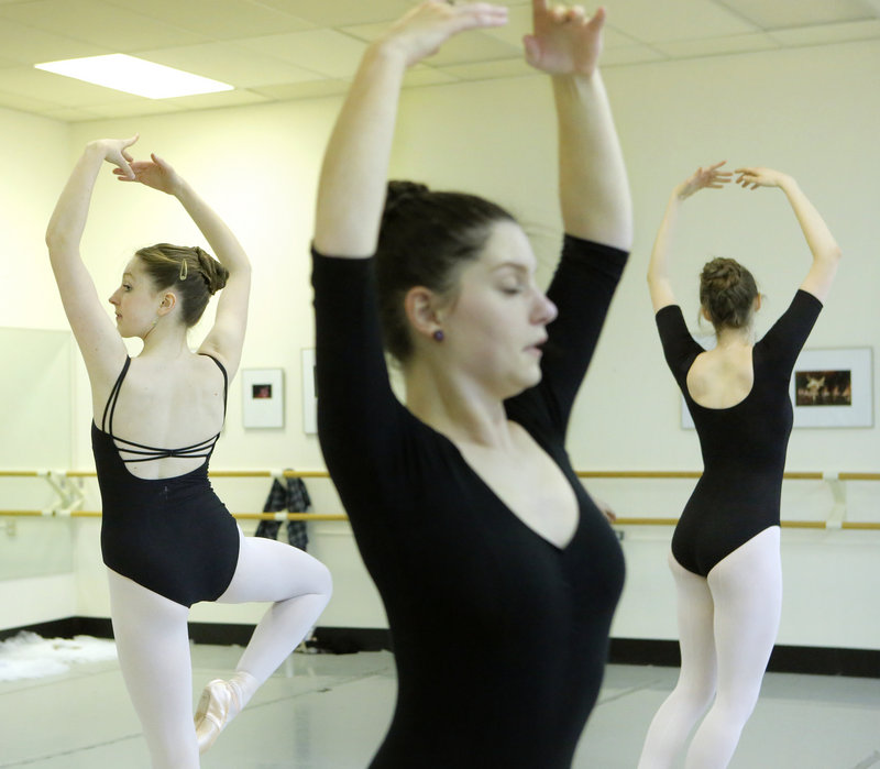 From left, Emily Avery, a senior at Exeter (N.H.) High School; Jacqueline Bolduc, a junior at Falmouth High School; and Quincy Dean, a senior at McAuley High School, practice part of a dance at Portland Ballet during training provided under the CORPS program.