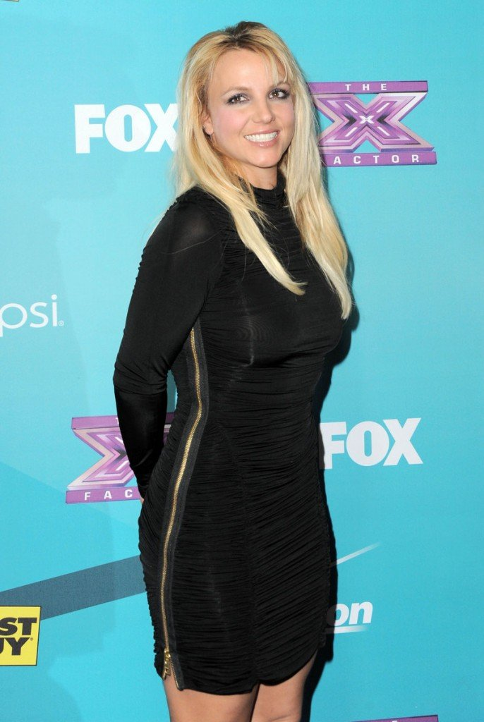 "Britney Spears is out as a judge on the ""X-Factor."" The pop singer failed to help boost ratings on the show."