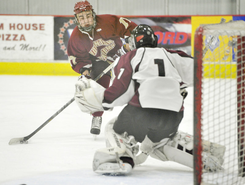 Owen Lemoine of Thornton Academy looks for an opening against Gorham goalie Justin Broy, who made the save on Lemoine's shot.