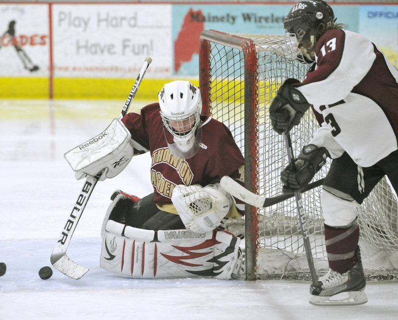 Thornton Academy goalie Andrew Huot makes a save as Gorham's Alex Lambert looks for a rebound Thursday at USM Ice Arena. Huot stopped 28 shots in a 7-4 win.