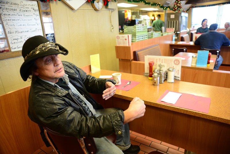 """Michael Lee of Wilmar, Minn., shown at a truck stop in Minneapolis in December, says, """"I don't have a home anymore. I live in the truck."""""""