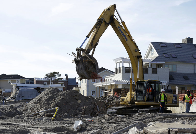 The remains of a house damaged by Superstorm Sandy and then bulldozed by a contractor are removed from the beach in the Belle Harbor section of the Rockaways on Thursday.
