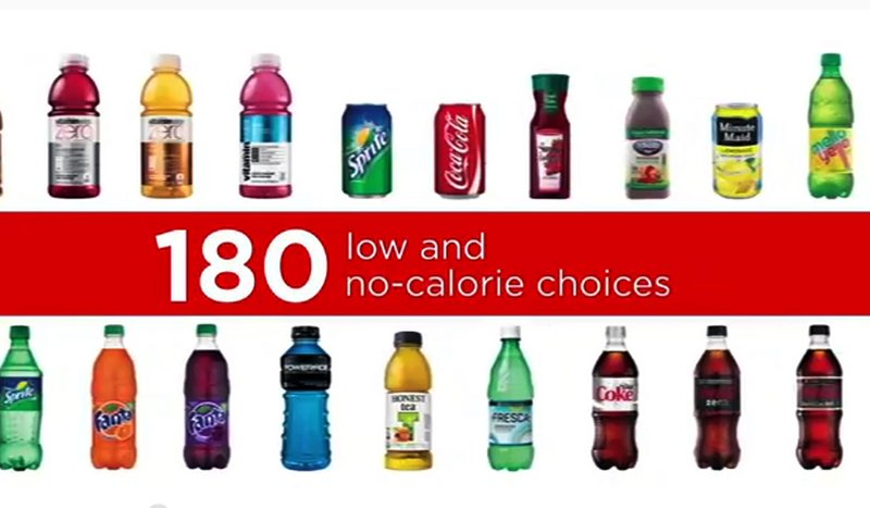 A 2014 commercial from Coca-Cola lays out the company's record of offering drinks with fewer calories over the years. An advocacy group is asking regulators to investigate whether manufacturers including Coca-Cola and PepsiCo have engaged in false or misleading advertising.