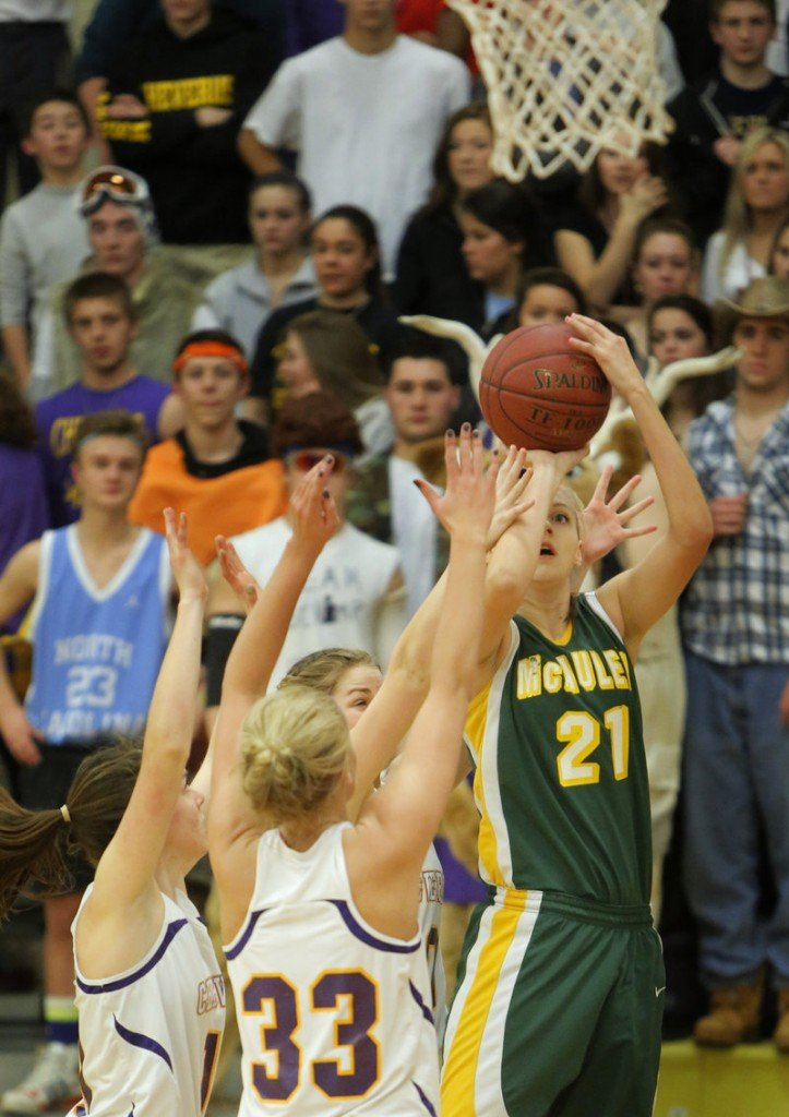 Olivia Smith, who played a strong post game Tuesday night for McAuley, takes a step outside to loft a jumper over the Cheverus defense, including Kylie Libby, 33, during a 51-30 victory.